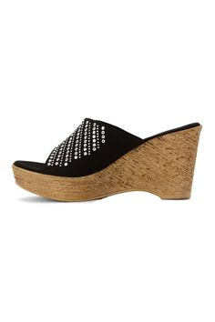 These are in US sizes. Make a fashion statement with the Kaelyn wedge by Onex. Pair with a sundress or even jeans for a more casual look. Lightly padded sole for added comfort; Slide in entry for easy on and off; Fabric upper and decorative stud accents for style. Runs slightly small; If you're a half size go up to the whole size. Platform Height: 1 1/4 inch Heel Height: 3 1/2 inches   Kaelyn Wedge Sandal by Onex. Shoes - Wedges Branford, Connecticut