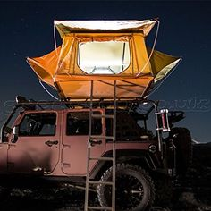 The Smittybilt Tent - With a jeep roof rack, you can mount, carry, & sleep in a tent on the top of the jeep.