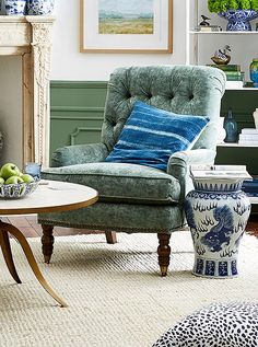 Indigo stripes add ease to a classic tufted armchair, upholstered in a soft sage green.