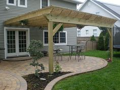 The following steps describe how to build a large attached pergola.