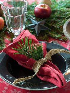 rustic winter or christmas place setting using burlap tied napkins with pine sprigs | gatherings + event ideas