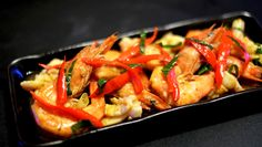 Vibrant and explosive with flavours as intense as its colour - Tom Yum Squid and Prawns Stirfry #kitchenmissus