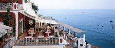 Le Sirenuse Hotel in Positano,  Located right off the coast next to the sea. Enjoy the beautiful sight right from your room or well decorated pool.
