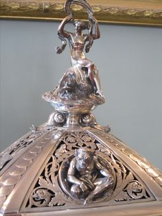 Silver mantle clock by Lund & Brockley, London. Designed by A. Crichton. Detail of casing.