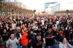 Gevo Lopez, 29, center, and thousands of other fans react to a Giants run at a World Series viewing party at Civic Center in San Francisco, Calif., Sunday, October 28, 2012. Photo: Jason Henry, Special To The Chronicle / SF