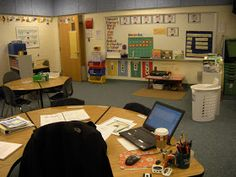 Black lines to differentiate student spaces at table Special Education classroom ideas. love how the teacher's desk is in the center of the classroom and very reachable instead of hidden away in a corner somewhere. Life Skills Classroom, Classroom Layout, Autism Classroom, Classroom Setting, Classroom Design, Future Classroom, School Classroom, Classroom Ideas, Classroom Resources