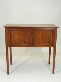 """Southern Huntboard. Walnut with Yellow Pine Secondary Wood. Consisting of Two Paneled Doors. Probably Georgia or North Carolina. Circa 1820-1850. 42-1/2"""" x 44-3/4"""" x 21-1/2""""."""