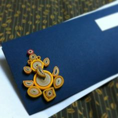 So…, Indians have a habit of giving money to children, family, friends, etc for birthdays, weddings, festivals and any kind of celebrations. So I quilled this Ganesha, the elephant God, who destroys any hindrances. The Ganesha/Ganapati is stuck on a hand-made envelope. :)
