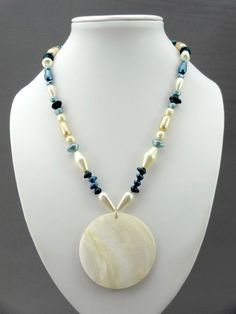 Teal & cream pearls with mother of pearl pendant