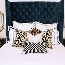 Love the leopard pillows with navy headboard