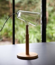 Frederik Delbart The Siblings Lamp Collection - THE SIBLINGS are a collection of lights with a wooden base and a transparent glass top.