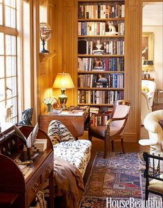 Love this home office/library. Can't you just see Hemingway plopped down at the desk, scribbling away?
