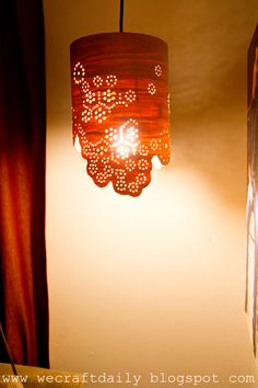 Wood Veneer Lampshade w/ holes drilled.   Looks so homey.  I could see this in my bedroom too!
