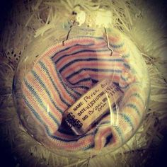 Baby's hospital bracelet and hat inside a glass ornament. Soo simple!