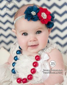 "Chunky bead necklaces are all the rage! A great accent for July 4th. It is made with large gumball-style pearl acrylic beads and made with a toggle clasp and has a 3"" extender chain. SHOP kids fashion for little girls at http://thinkpinkbows.com/products/patriotic-nautical-bling-necklace 