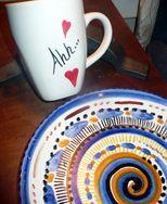 Ceramic dish or mug and permanent markers.