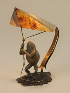 Can't help but laugh at the frog flying his kite of penshell and brass.  New decorative lamp at Maitland-Smith.