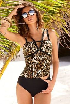 2e8ce9b9d2 Double straps and a keyhole cutout define the sexy neckline of this leopard  animal print pull-on tankini top. Spotted on Boston Proper.