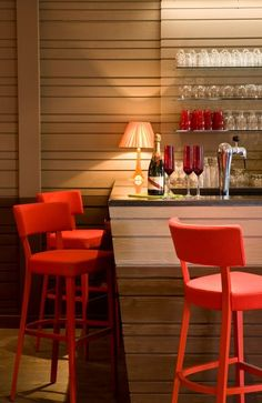 bar with red accents. so cute. this could be a breakfast bar or a soda fountain, too.