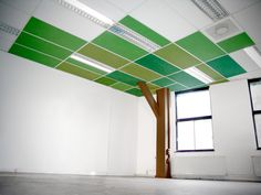 I love the idea of painting each ceiling panel a slightly different color...maybe different blues like the sky. We could add white cloud decals. We could do this just over the roadway/ physical play area (center of room). We could paint the large columns brown like a tree as well.