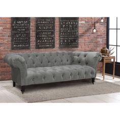 Beautiful- substitute button-tufted pillows in a pewter-colored velvet to get a bit of the effect.
