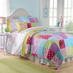 Look at wall color.  Patchwork Reversible Comforter Set - BedBathandBeyond.com