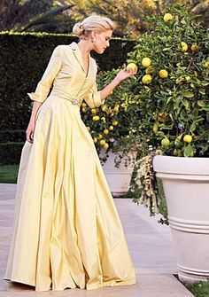 #@ClassicalGown.  Reminds me of Grace Kelly.  Pale yellow gown.  Shirt style gown.  Love the orange tree.  Elegant life.