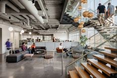 Rapt Studio has designed the interiors for tech company Ancestry's new office, which features comfy lounge areas, communal dining tables and art installations that refer to genealogy.