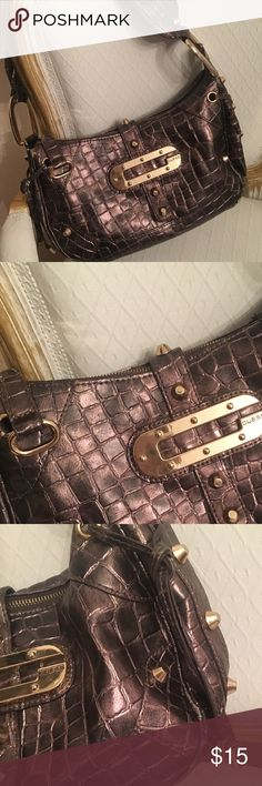 Guess faux reptile bronze purse w/ gold studs Guess faux reptile bronze purse with gold studs. In good used condition. Definitely still has life left! Some use on corners by strap  as pointed out in pictures- otherwise- good condition!! Guess Bags Shoulder Bags