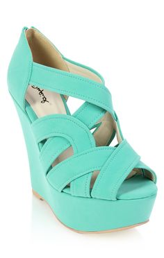 peep toe wedge with cutouts. Mint
