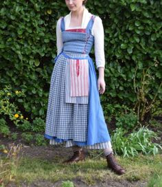 This beautiful made to measure Belle Town Costume is as movie accurate as they come! The costume includes: -blouse with back zipper -bodice with back zipper -petticoat with elasticated waist -skirt with elasticated waist and decorative stitching -apron -pockets (the red pocket is a functional one) -blue hair ribbon -fichu The pockets and apron are 100% cotton linen and the rest is synthetic/cotton blend. The majority of the items are tea-dyed and distressed and I would therefore not rec...