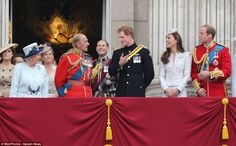 The entertainers: Prince Harry and Prince Philip keep the rest of the family entertained as they stand on the balcony of Buckingham Palace for the RAF flypast
