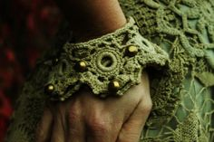 fairy pirate bohemian style romantic crochet lace arm cuffs wrist warmers bracelet in sage and olive green lace with brass studs