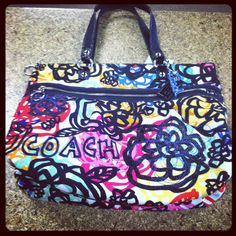 Coach.   Love this! Only if it was a cross body!!