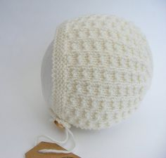 Cream Baby Bonnet hand knitted by WoollywonderKnits