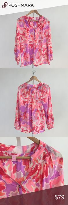 Lilly Pulitzer Elsa Top in Soirée Serenade Print Classic silk blouse in a pink and purple abstract floral print. Loose fitting with long sleeves and smocking at neck. Dry clean only. Last photo from Lilly Pulitzer to show fit. Please carefully review each photo before purchase as they are the best descriptors of the item. My price is firm. No trades. First come, first served. Thank you! :) Lilly Pulitzer Tops Blouses