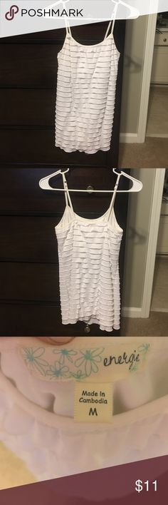 White ruffle tank top White ruffle tank top with lining and adjustable straps. Body: 98% polyester 2% spandex. Lining: 95% cotton 5% spandex. Tops Tank Tops