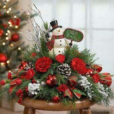 Frosty holiday arrangement with evergreens, carnations, and a snowman, our favorite jolly happy soul to have around this Christmas! Christmas Tabletop, Christmas Table Centerpieces, Christmas Tablescapes, Xmas Decorations, Christmas Candles, Christmas Flower Arrangements, Christmas Flowers, Christmas Time, Christmas Wreaths