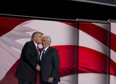 Donald Trump and  Mike Pence on stage at the 2016 Republican National Convention in Cleveland, Ohio, on July 20, 2016.