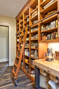 Love this pantry, the ladder, and the counter top storage