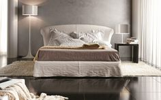 comfortable cream fabric bed frame completes this gorgeous room