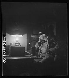 Waynoka, Oklahoma. Brakeman Jack Torbet, sitting at the window of the caboose pulling out of Waynoka, Oklahoma on the Atchison, Topeka, and Santa Fe Railroad, 1940s.  Photo by Jack Delano. LOC