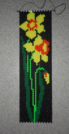This is a Spring Daffodils Beaded Banner with black nylon cord for hanging. Finished Size is: 6 wide x 21  long. without hanger Size with Cord Hanger: 6