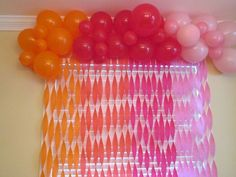 My daughter's second birthday decor. Birthday decorations - balloons and streamers in orange, red, magenta and pink! Ombré balloons!