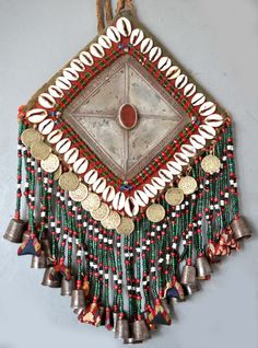 Gonzuk with cowries, beading , coins, glass cut beading, embroidery pendants, seeds and thimbles. 19 th c Ersari tribe (private collection Linda Pastorino)