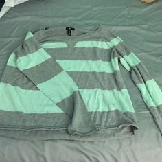 Mint Green & Grey striped sweater Soft, comfortable, loose fitting sweater. No stains.. Love this sweater but it doesn't fit anymore :( GAP Sweaters
