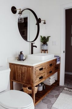 A must-see DIY bathroom remodel that's a lesson in how to transform a dreary space into a dream room with easy bathroom decor updates and budget-friendly hacks. Diy Bathroom Remodel, Bathroom Renos, Bathroom Renovations, Bathroom Storage, Bathroom Interior, Bathroom Ideas, Bathroom Makeovers, Wooden Bathroom Vanity, Budget Bathroom