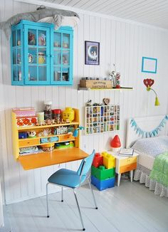 Kid's room. White + color. I like the bunting on the bed, the nightstand, the chair, and the stuffed shark.