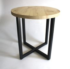 Simple design makes this small table big on statement. The Banco has a box steel frame. crossed at floor level and its reclaimed wood round top makes it a stylish side table or coffee table. #interiors #interiordesign #Scandi #reclaimedwood #furniture