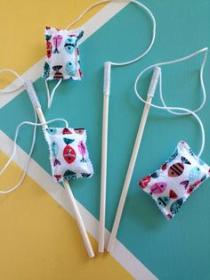 Handmade cat toy for your feline friend! The wand: wood 12 long The rope: 25 long The toy: 4long & filled with cotton, jingle bells and organic catnip My cat goes crazy with her cat wand and I am sure yours will too!! *This toy is recommended for declawed cats.*The material used for the toy is flannel and fleece. If you have any questions please feel free to message us